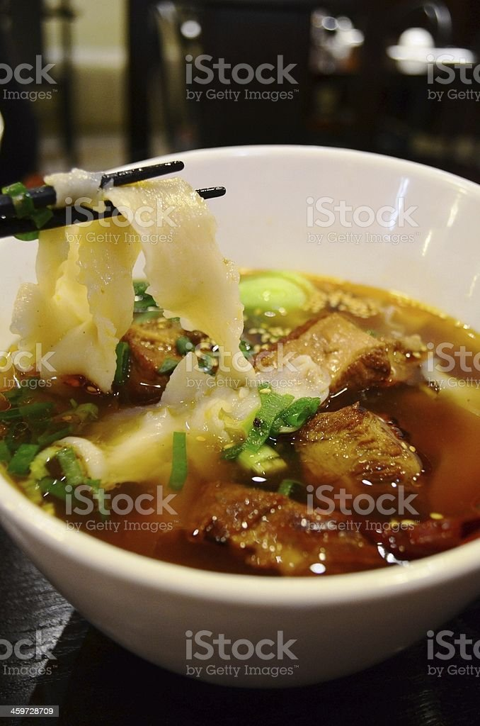 Knife-shaved noodles with pork stock photo