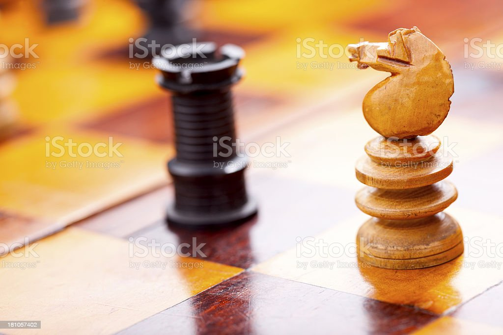 Knight And Castle On An Antique Chess Board royalty-free stock photo