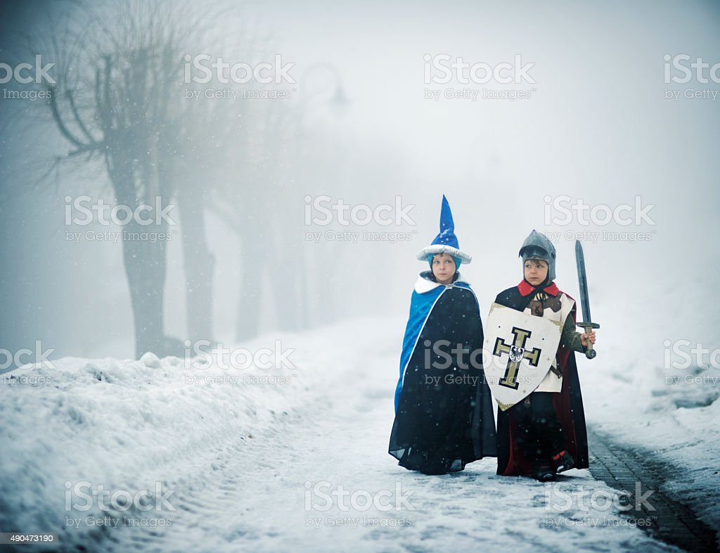 Knight and wizard on a scary winter quest stock photo