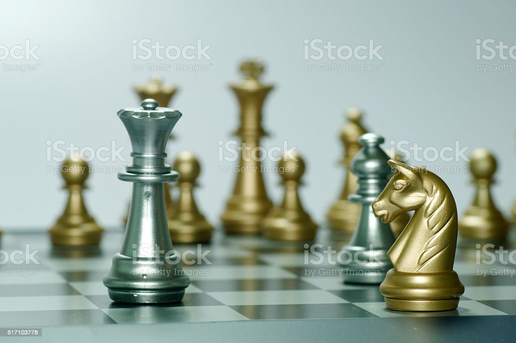 Knight attacking Queen stock photo