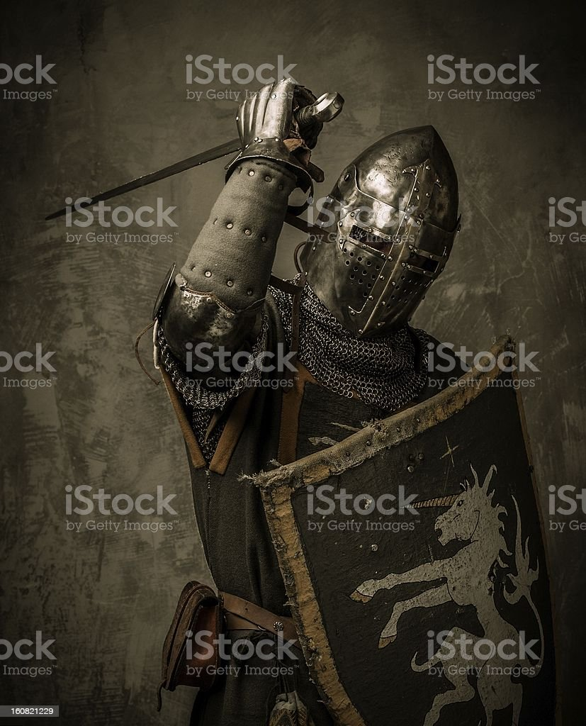 A knight holding a shield and sword stock photo