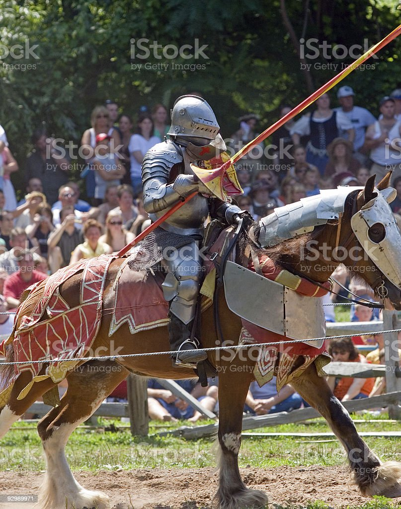 Knight in Armor on a Charging Horse, Jousting stock photo