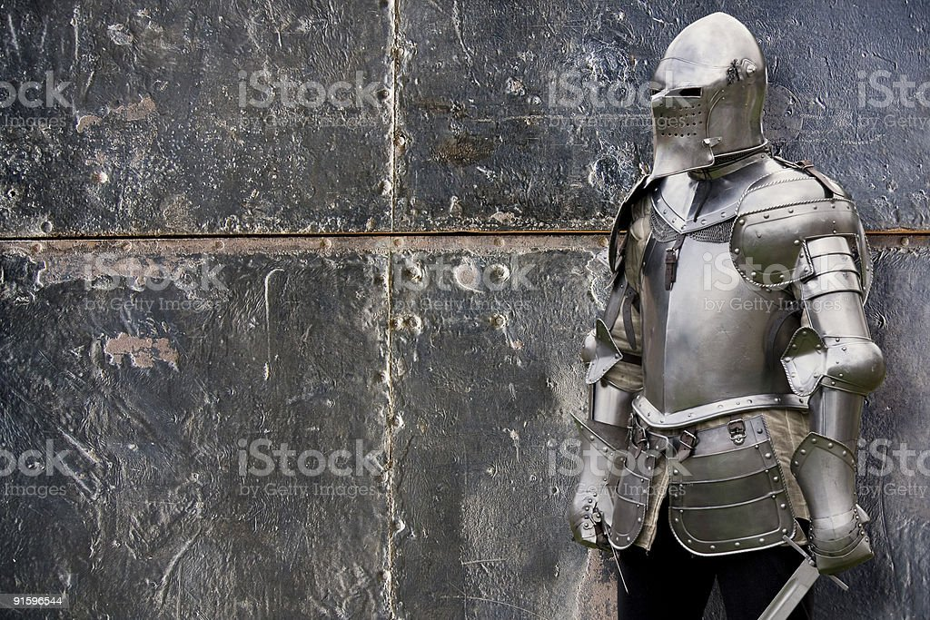 Knight in armored suit stock photo