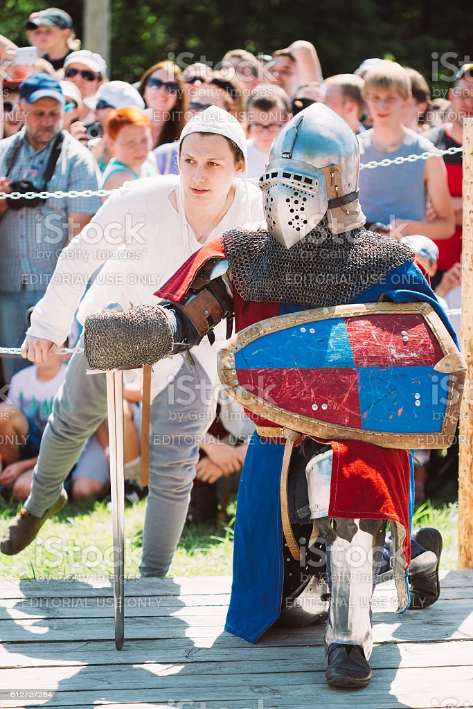 Knight In Fight With Sword. Restoration Of Knightly Battle stock photo