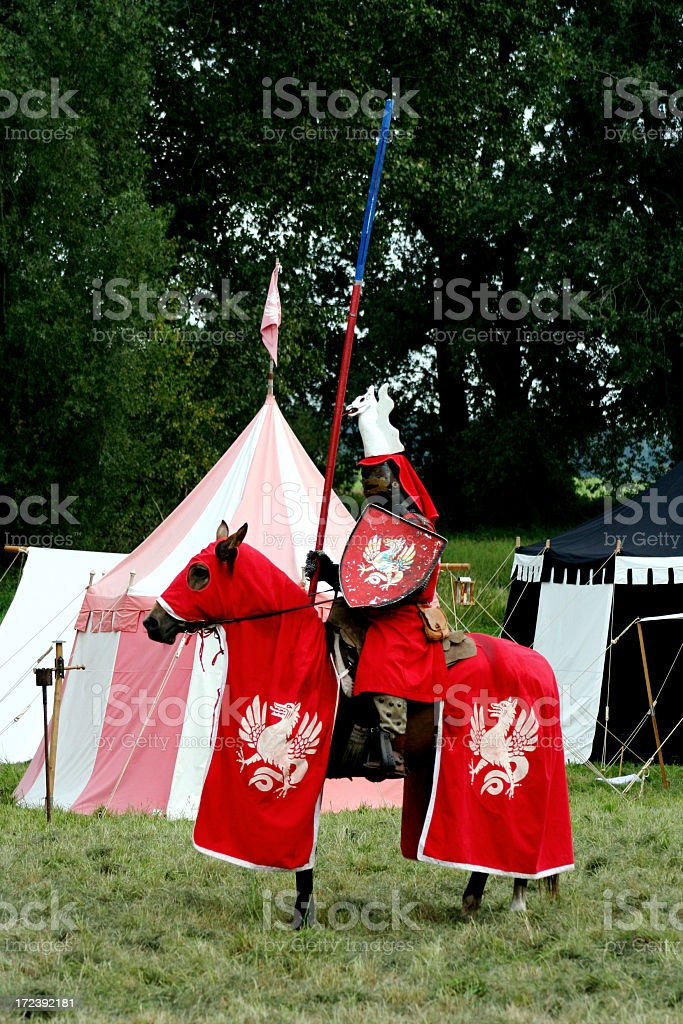 knight in full armor ready for lance competition royalty-free stock photo