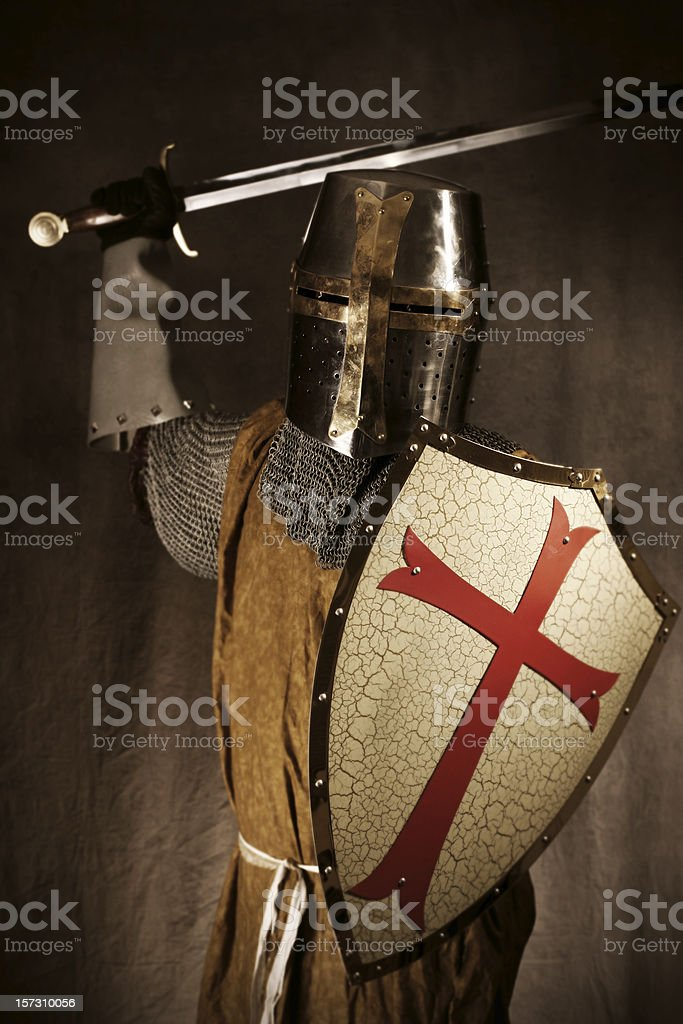 Knight or Crusader Attacking with Sword and Shield stock photo
