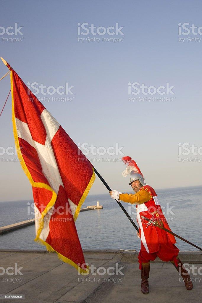 Knight waving flag stock photo