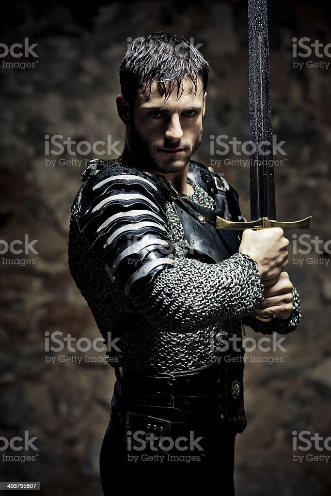 Knight with sword in the darkness stock photo