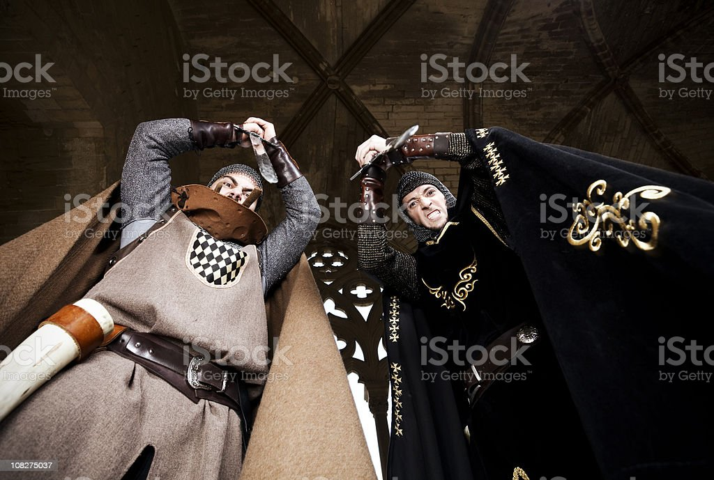 Knights about to stab stock photo