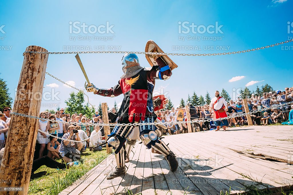 Knights In Fight With Sword. Restoration Of Knightly Battle stock photo