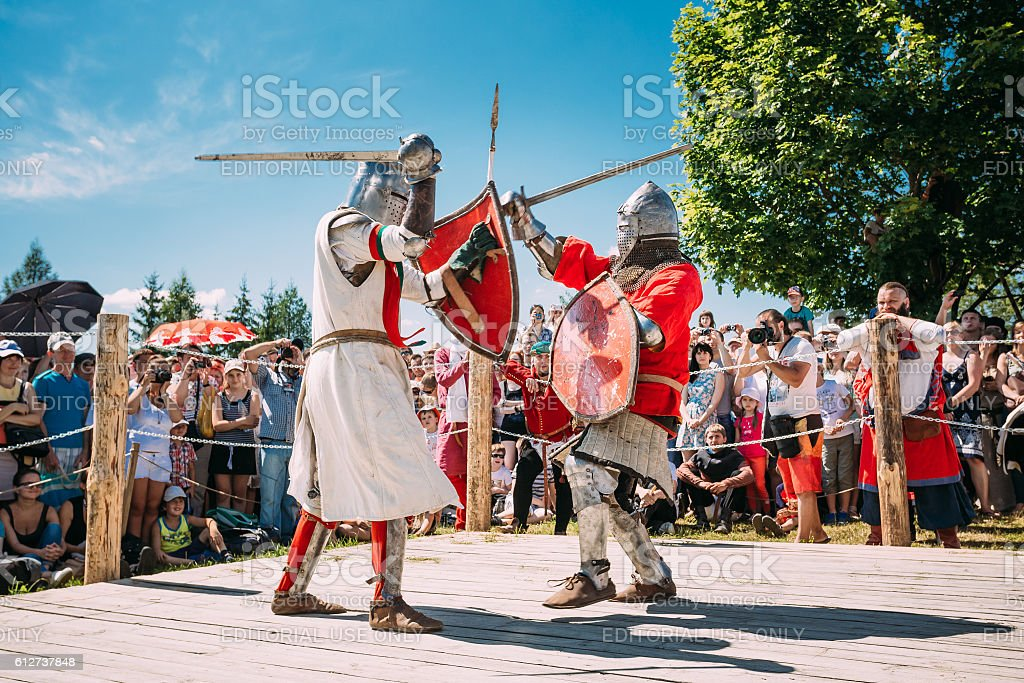 Knights In Fight With Swords. Restoration Of Knightly Battle stock photo