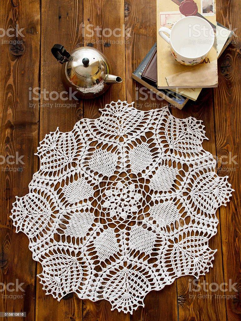 knited openwork crochet doily stock photo