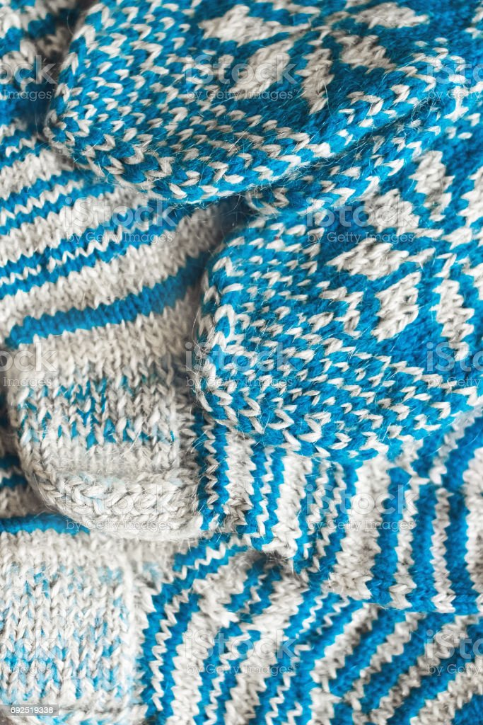 Knitted mittens and socks jacquard pattern stock photo