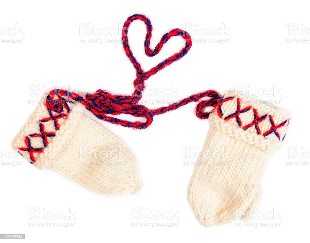 knitted mittens linked with a string shaped as a heart stock photo
