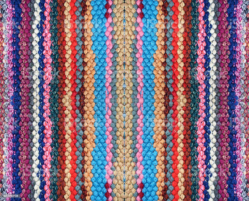 Knitted rug with a pattern of stripes stock photo