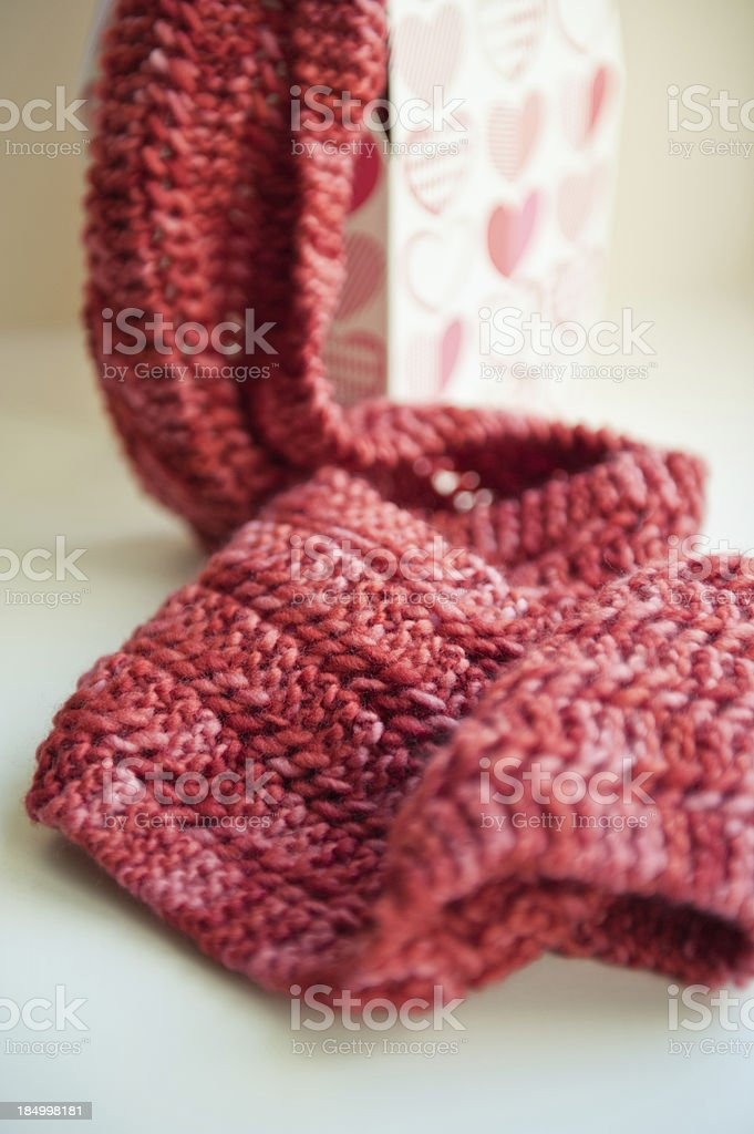 Knitted Scarf in a gift box stock photo