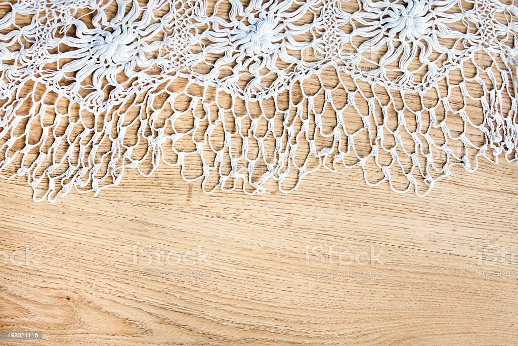 Knitted tablecloth on wooden background stock photo