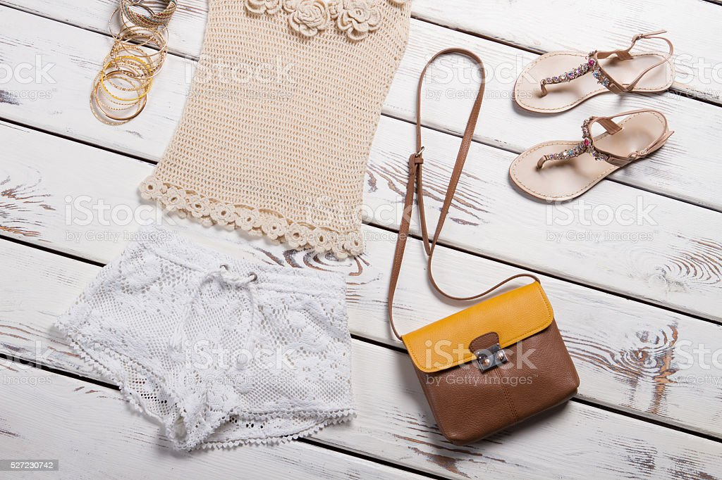 Knitted t-shirt and shorts with accessories. stock photo