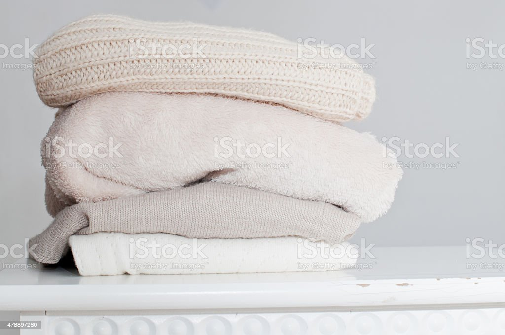 Knitting clothes in basket stock photo