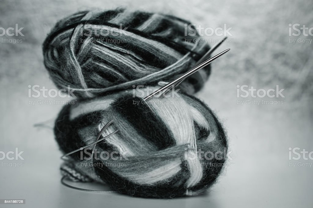 knitting needles and wool ball stock photo