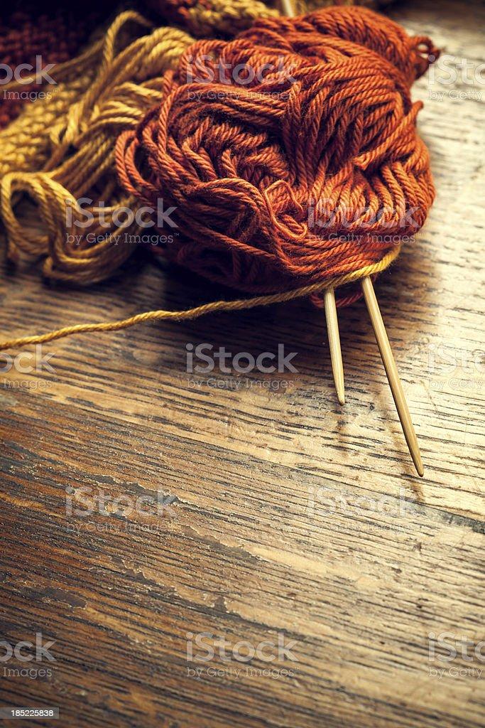 Knitting Needles and Yarn on Wood stock photo