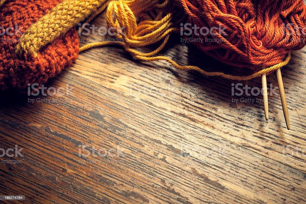 Knitting Needles and Yarn on Wood royalty-free stock photo