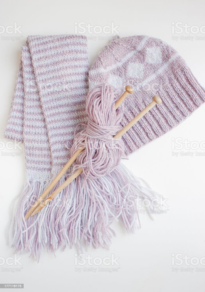 Knitting needles, woollen scarf, winter hat. stock photo