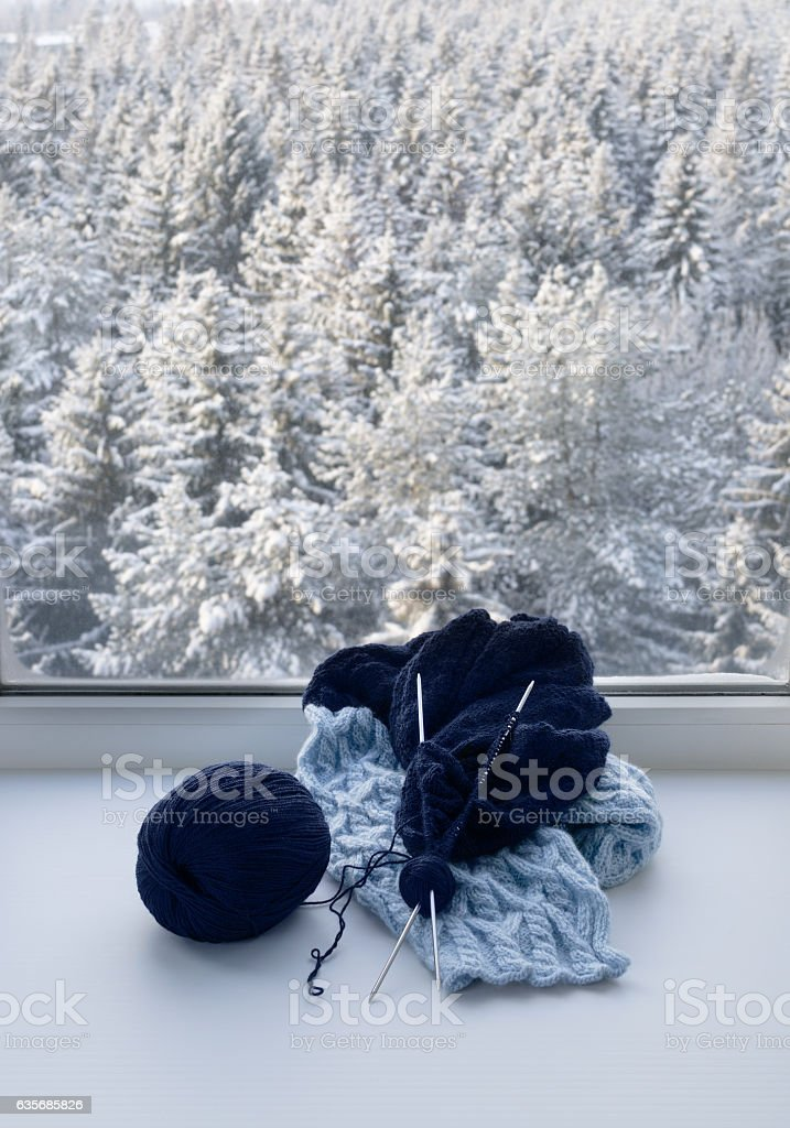 Knitting on windowsill stock photo