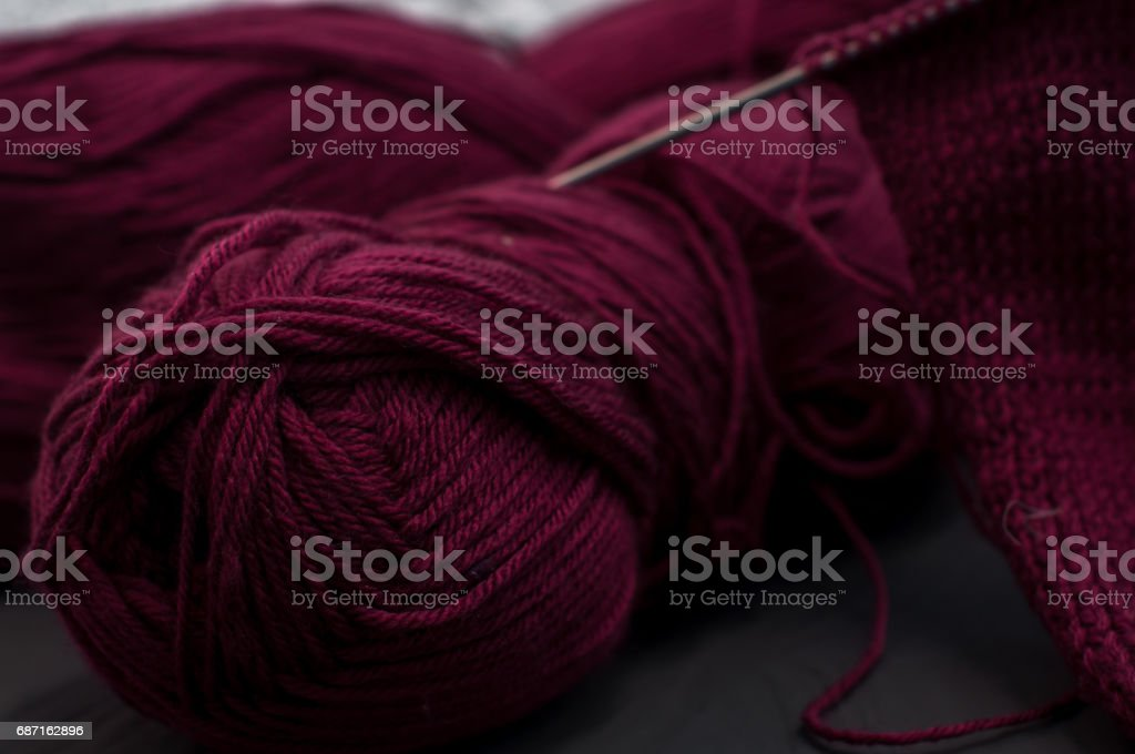 Knitting purple Set On Wooden Table stock photo