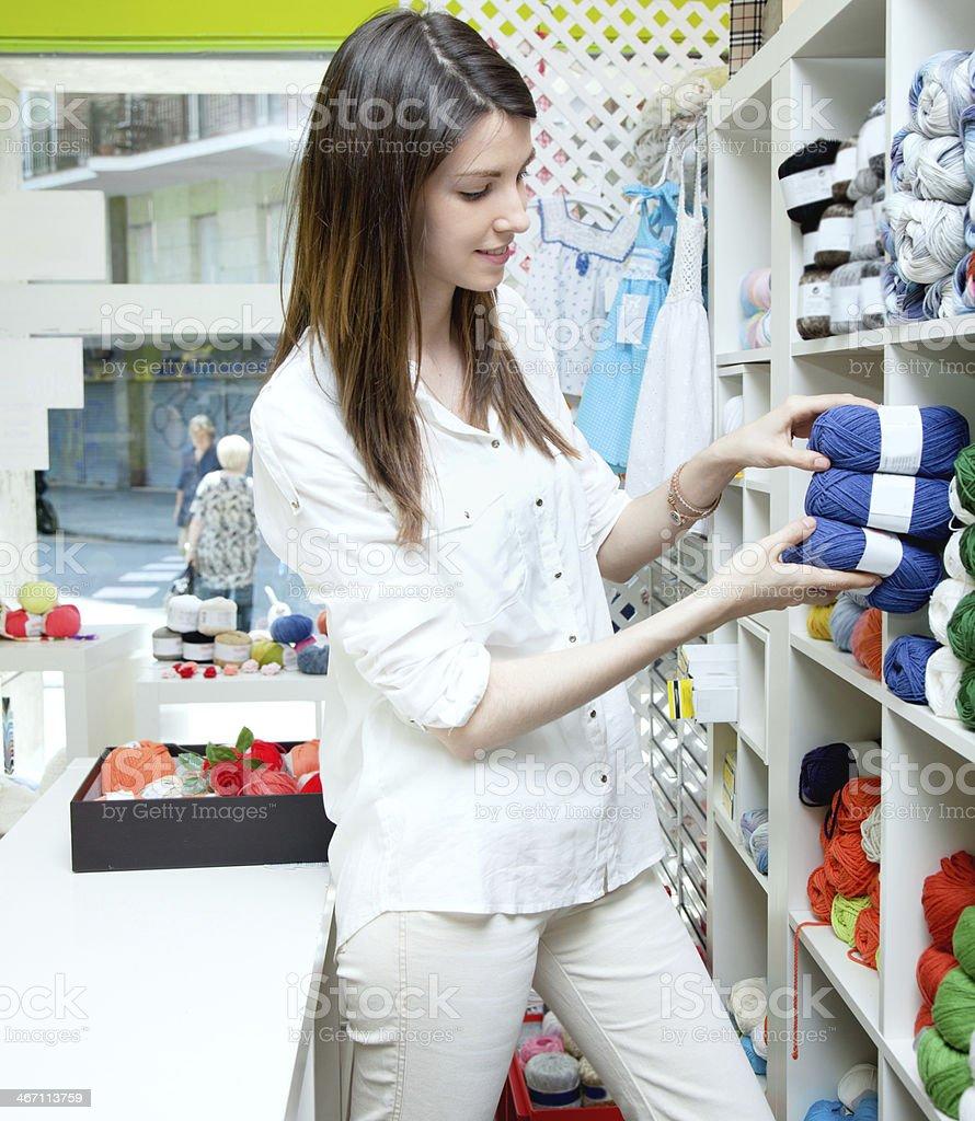 Knitting shop atendant royalty-free stock photo