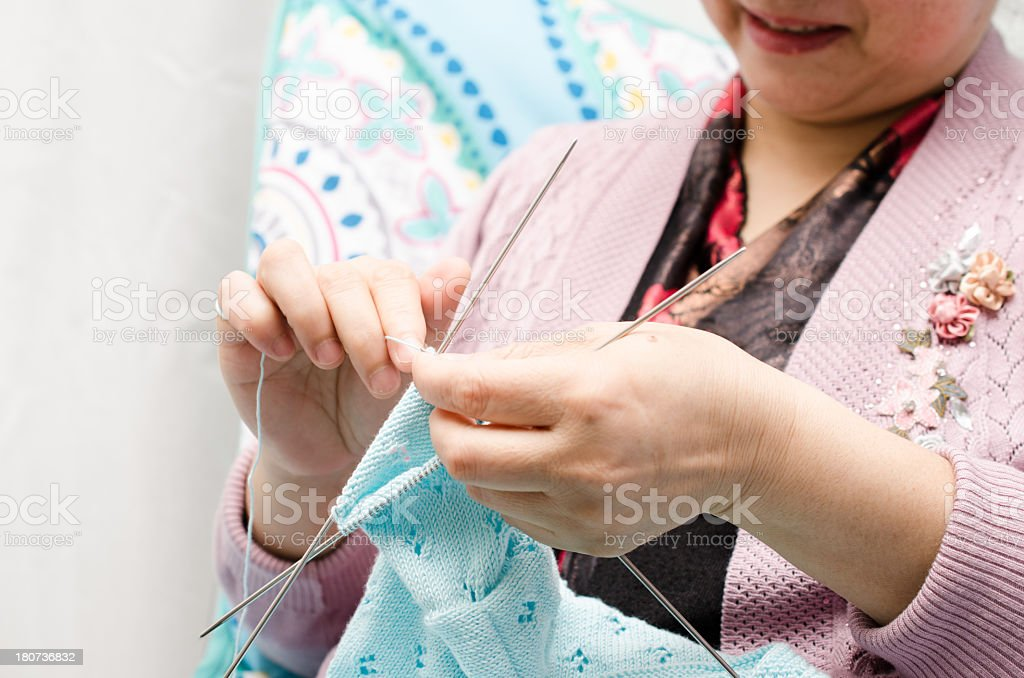 woman kniting sweater