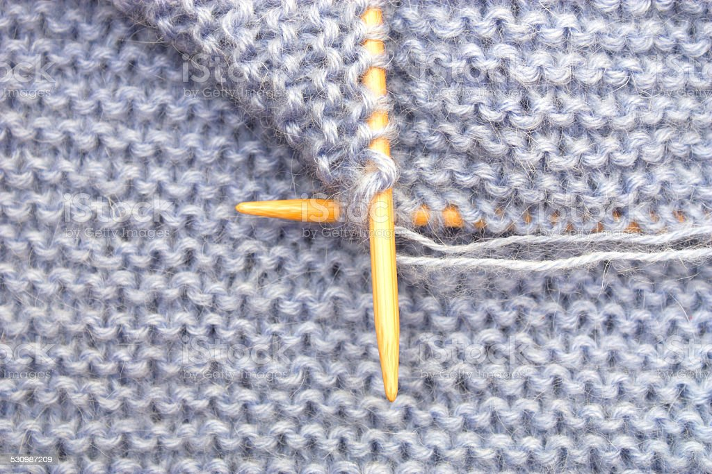 Knitting with bamboo needles stock photo