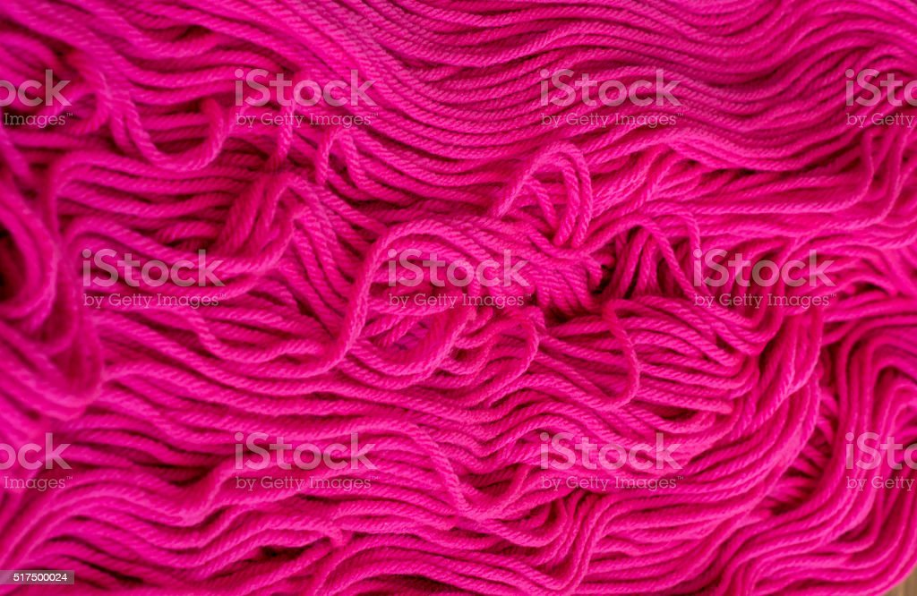 Knitting yarn fuchsia stock photo