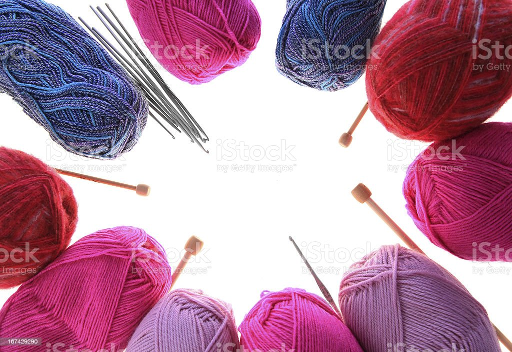 Knitting yarn, needles and crochet hooks frame royalty-free stock photo
