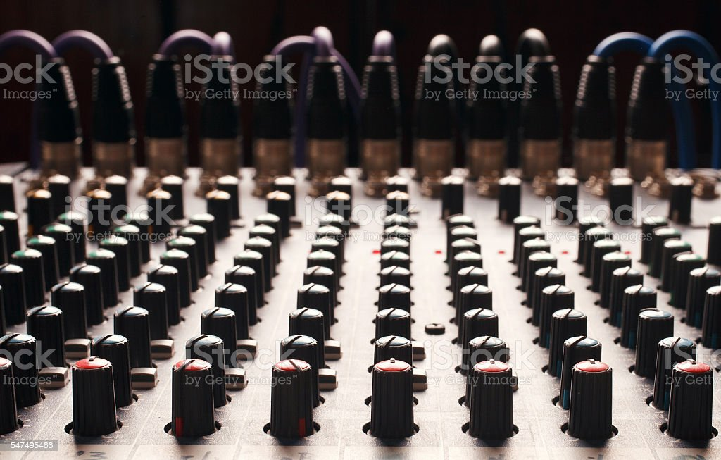 Knobs of a studio soundboard stock photo