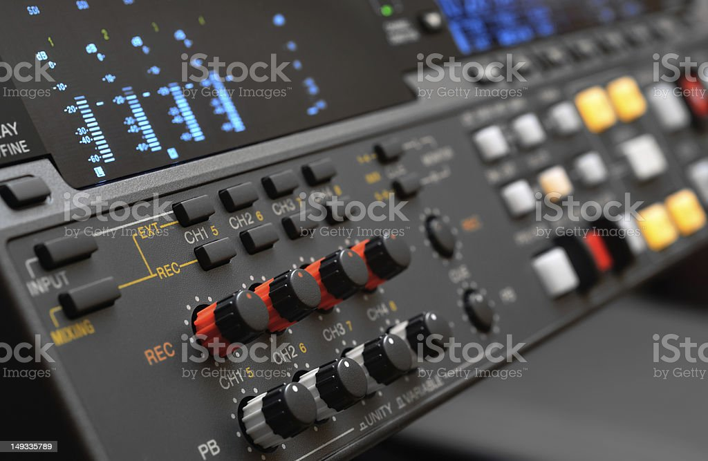 10 knobs on a gray professional digital video recorder stock photo