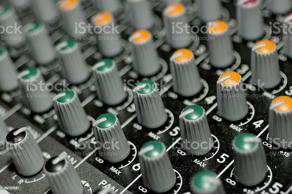 Knobs on a mixing deck stock photo