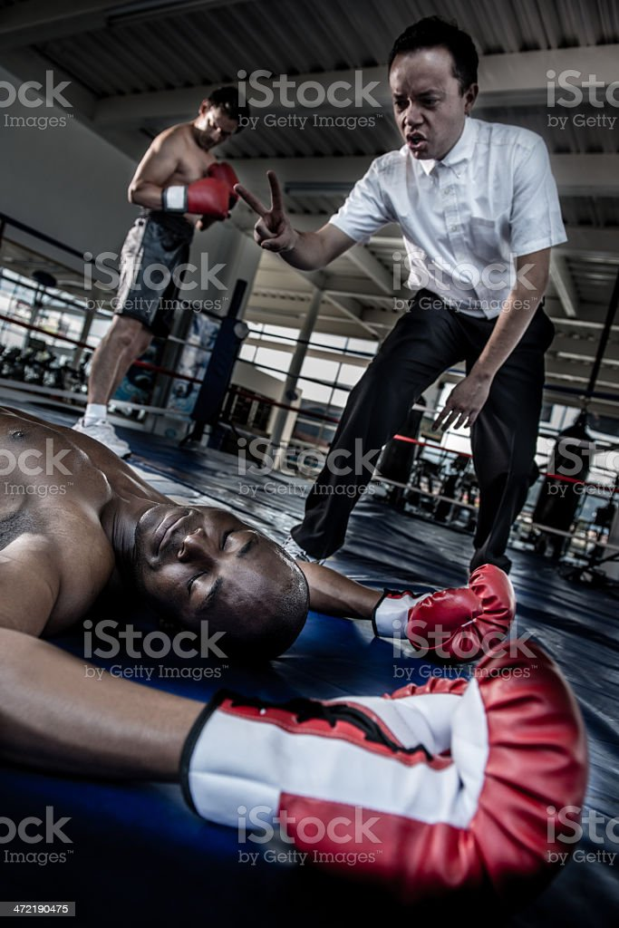 Knock out at the boxing ring stock photo