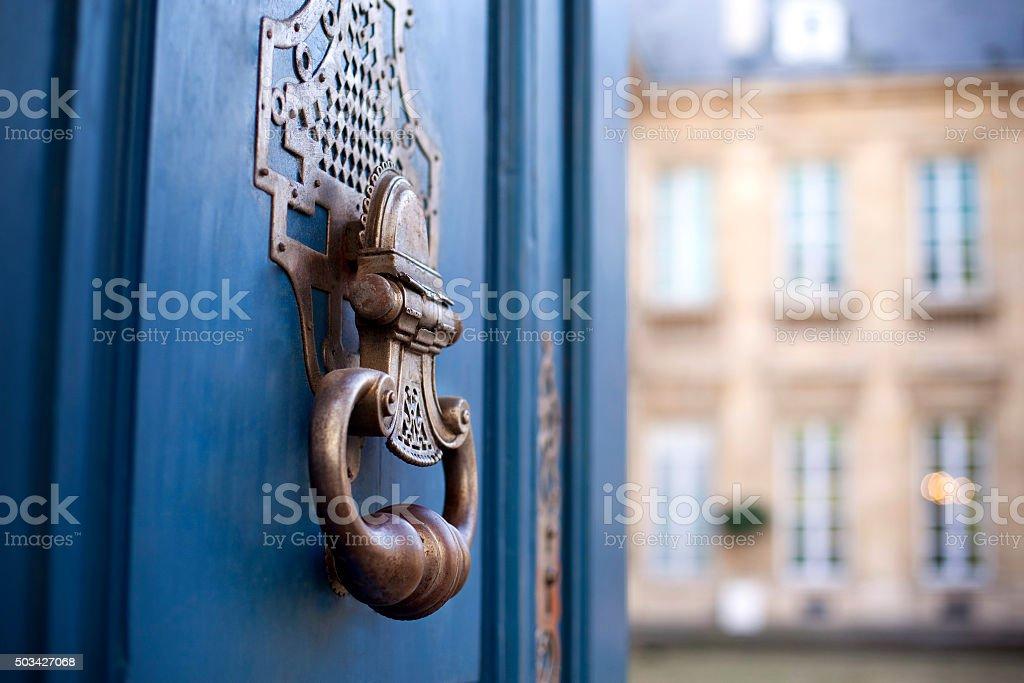 Knocker on a door stock photo
