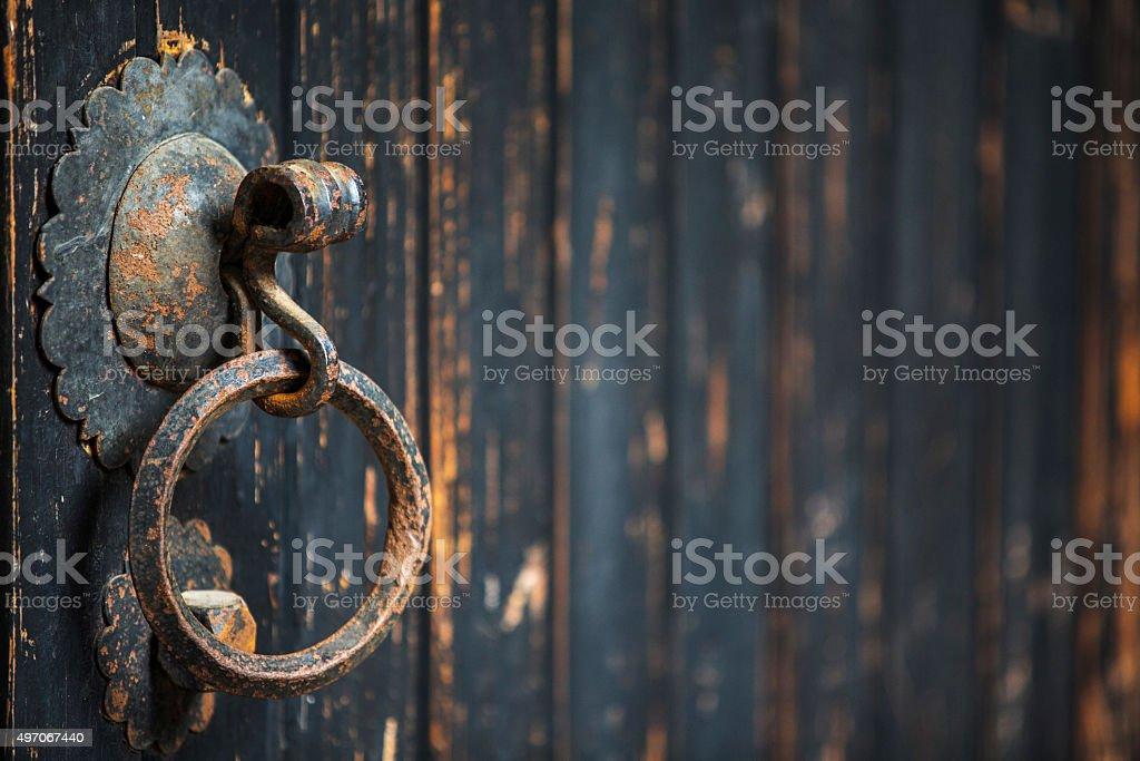 knocker on old wooden door stock photo