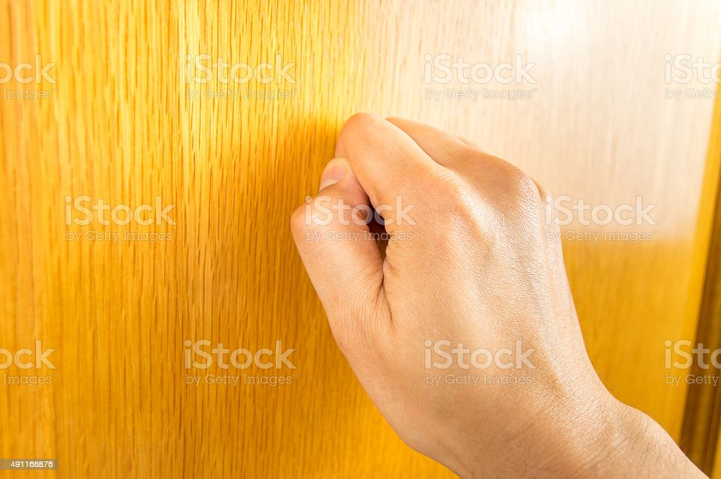 knocking at the door stock photo