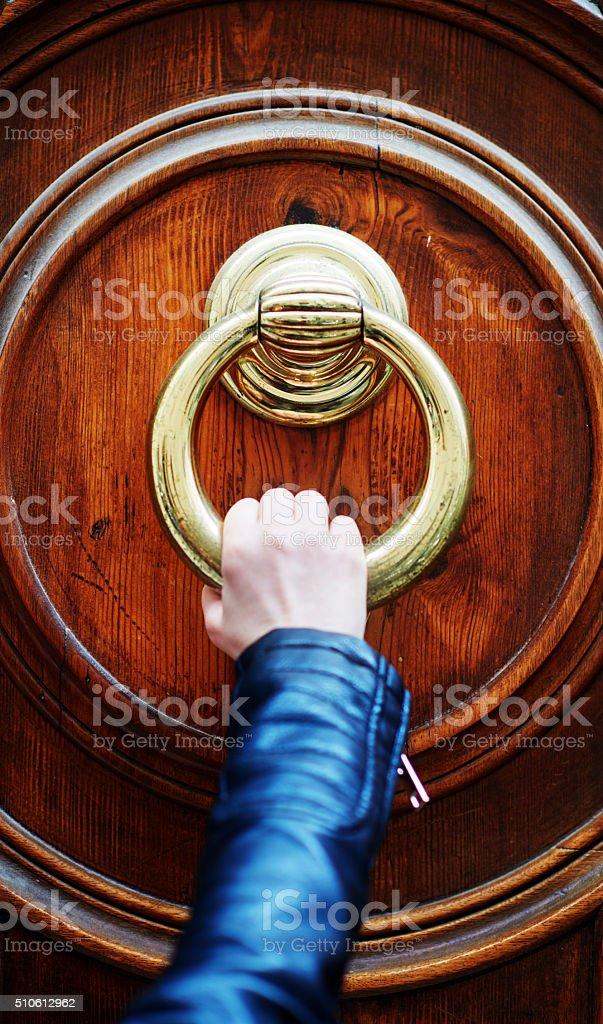 knocking on the door stock photo