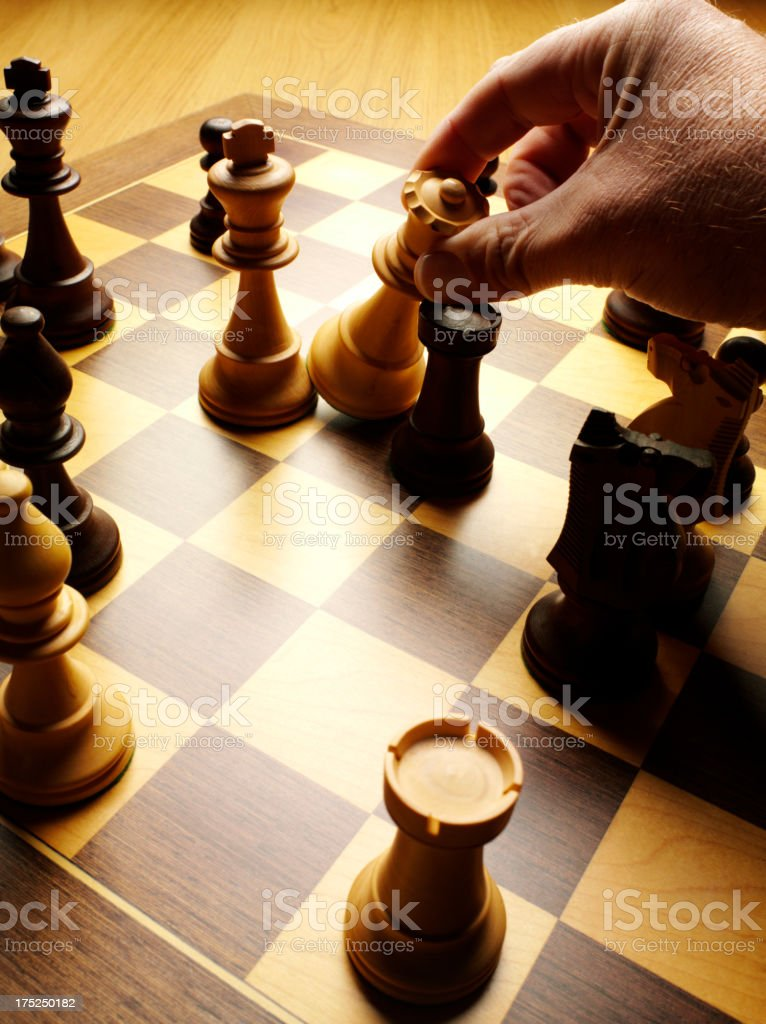 Knocking out of the King by a Queen in Chess royalty-free stock photo