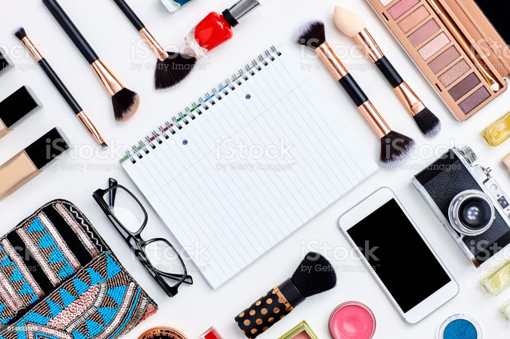 Knolling concept - note book flat lay with beauty products stock photo