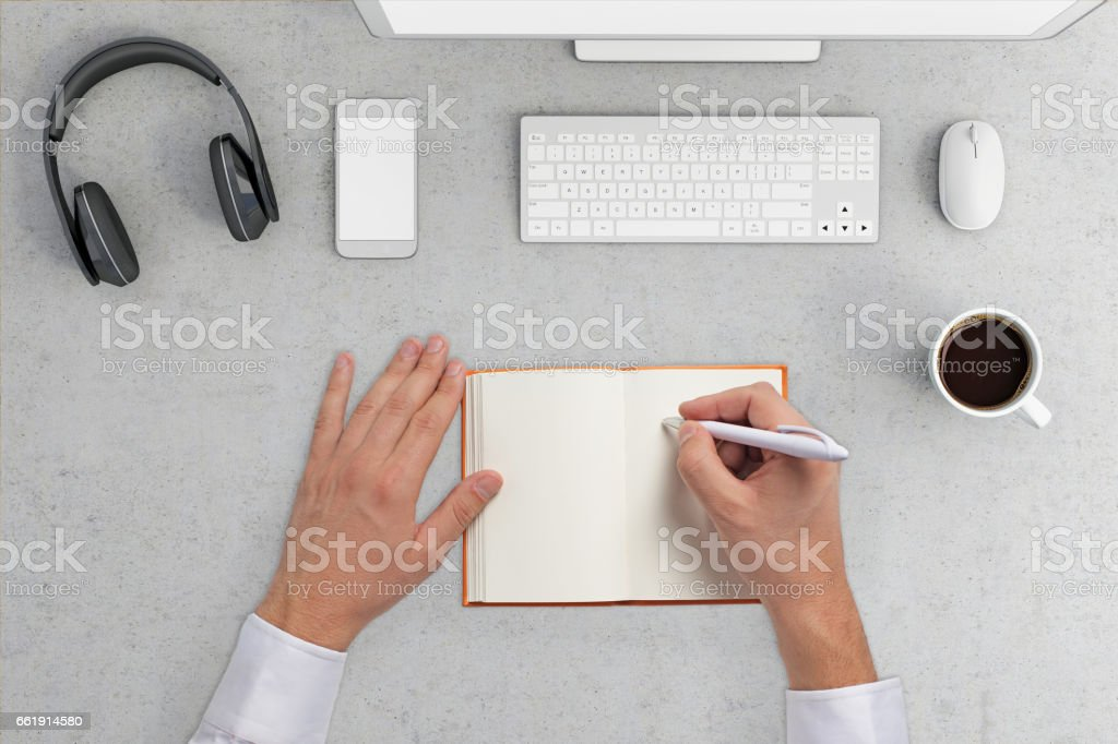 Knolling hands writing in the blank notebook stock photo