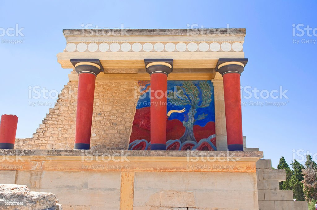 Knossos palace with charging bull on background on Crete, Greece. stock photo