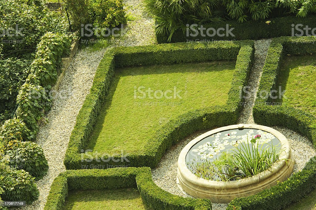 knot garden with pool stock photo