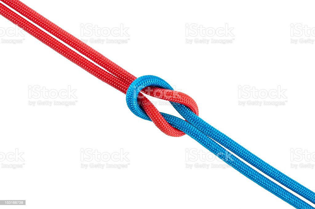 Knot made from red and blue cords stock photo