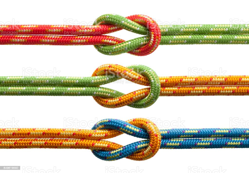 Knots with colored ropes stock photo