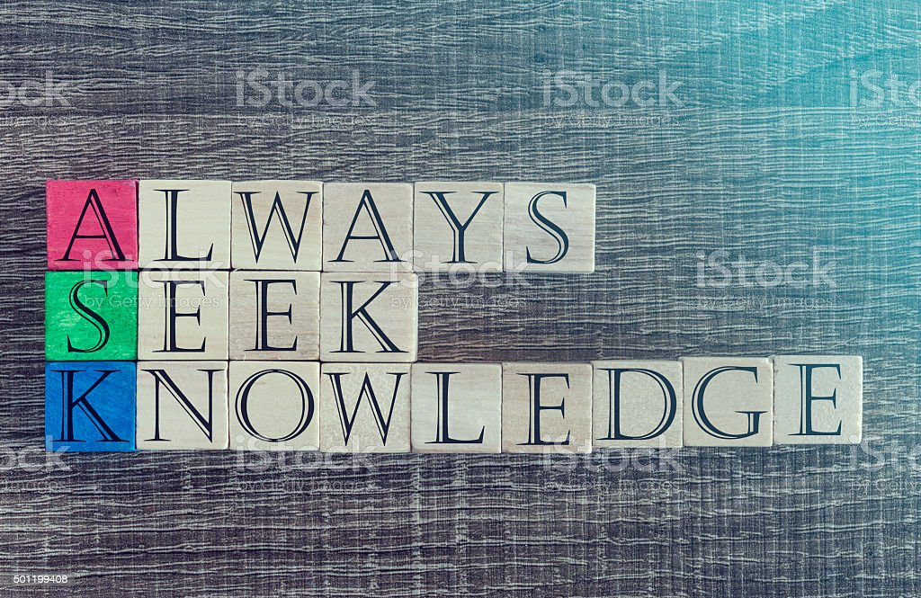 Knowledge concept with quote written on wooden blocks stock photo
